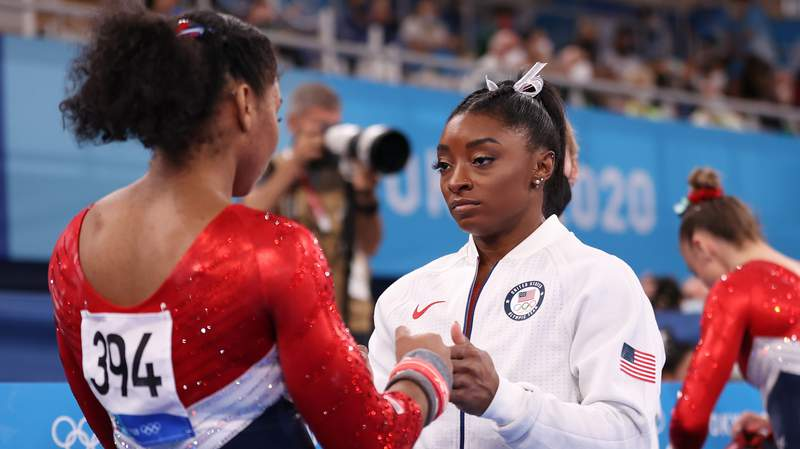 Simone Biles encourages teammate Jordan Chiles during the team final of the women's artistic gymnastics competition in Tokyo. Biles only competed on the vault and will not compete on other events.