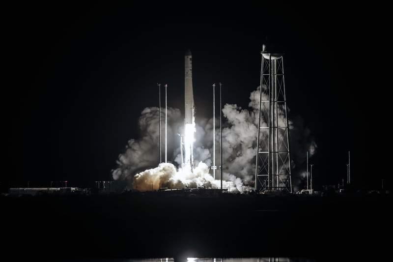Northrup Grumman's Antares rocket lifts off the launch pad at the NASA Wallops test flight facility, Friday, Oct. 2, 2020, in Wallops Island, Va. The rocket will deliver supplies to the International Space Station (Thom Baur/Northrup Grumman via AP )
