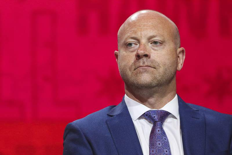 FILE - In this July 26, 2019, file photo, Chicago Blackhawks senior vice president and general manager Stan Bowman attends the NHL hockey team's convention in Chicago. Bowman has pledged to participate in and cooperate with an investigation into allegations that a former Chicago Blackhawks assistant coach sexually assaulted two players in 2010.  (AP Photo/Amr Alfiky, File)