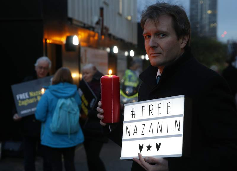 FILE -- In this Jan. 16, 2017 file photo, Richard Ratcliffe husband of imprisoned British-Iranian dual national Nazanin Zaghari-Ratcliffe, poses during an Amnesty International led vigil outside the Iranian Embassy in London. Nazanin Zaghari-Ratcliffe, an Iranian-British woman long held in Tehran has been sentenced to another year in prison in Iran, her lawyer said Monday, April 26, 2021. (AP Photo/Alastair Grant, File)