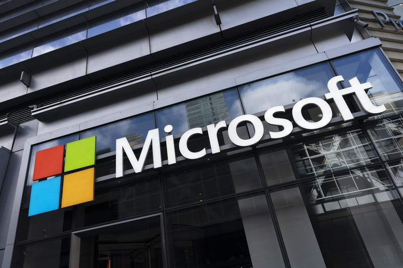 This May 6, 2021 photo shows a sign for Microsoft offices in New York.  Microsoft has unveiled the next generation of its Windows software, called Windows 11, that has a new start menu and other features. The newest version of Microsofts flagship operating system announced Thursday, June 24,  will be a successor to todays Windows 10, which the company introduced in 2015.  (AP Photo/Mark Lennihan)
