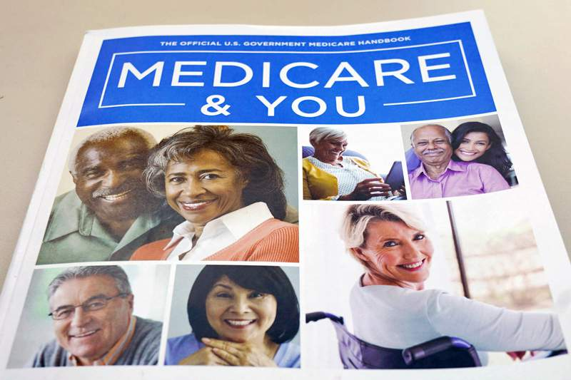 FILE - In this Nov. 8, 2018 file photo, the U.S. Medicare Handbook is photographed in Washington.  The Senate has confirmed President Joe Bidens pick to run U.S. health insurance programs, putting in place a key player wholl carry out his strategy for expanding affordable coverage and reining in prescription drug costs. Obama-era policy adviser Chiquita Brooks-LaSure will be the first Black woman to head the Centers for Medicare and Medicaid Services, or CMS, which also administers childrens health insurance and the Affordable Care Act.  (AP Photo/Pablo Martinez Monsivais)