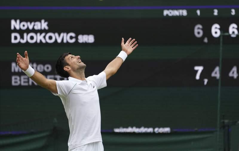 Serbia's Novak Djokovic celebrates his victory over Italy's Matteo Berrettini in the men's singles final match on day thirteen of the Wimbledon Tennis Championships in London, Sunday, July 11, 2021. (AP Photo/Alberto Pezzali)
