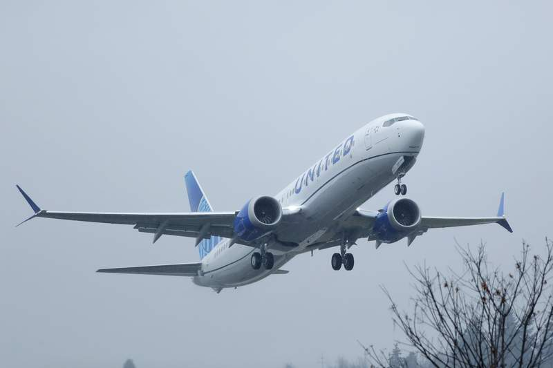 FILE - In this Wednesday, Dec. 11, 2019, file photo, a United Airlines Boeing 737 Max airplane takes off in the rain, at Renton Municipal Airport in Renton, Wash. Federal auditors are issuing fresh criticism of the government agency that approved the Boeing 737 Max. The Transportation Department's inspector general said Wednesday, Feb. 24, 2021, that the Federal Aviation Administration must improve its process for certifying new planes.  (AP Photo/Ted S. Warren, File)
