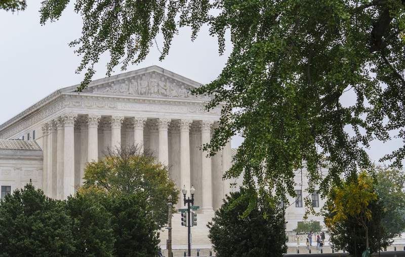 The Supreme Court is seen as morning fog lingers on Capitol Hill in Washington, Wednesday, Oct. 21, 2020. (AP Photo/J. Scott Applewhite)