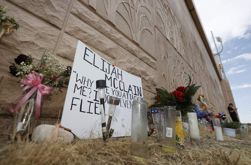 FILE - In this July 3, 2020, file photo, a memorial site across the street from where Elijah McClain was stopped by Aurora, Colo., Police Department officers stands along Interstate 225 before a news conference in Aurora, Colo. The local investigation in connection with the death of the 23-year-old Black man who died after police stopped him on the street in suburban Denver last year will be led by a former Justice Department lawyer who oversaw its investigation of police in Ferguson, Missouri, following the death of Michael Brown in 2014. (AP Photo/David Zalubowski, File)
