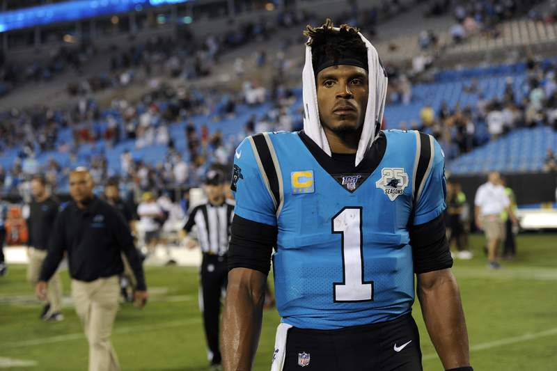 FILE - In this Sept. 13, 2019, file photo, Carolina Panthers quarterback Cam Newton (1) walks off the field following the Panthers 20-14 loss to the Tampa Bay Buccaneers in an NFL football game in Charlotte, N.C. The Panthers are parting ways with Cam Newton. Carolina general manager Marty Hurney said Tuesday, March 17, 2020, via Twitter the team is giving the 31-year-old quarterback permission to seek a trade _ although the former league MVP responded by saying he never requested one. (AP Photo/Mike McCarn, File)