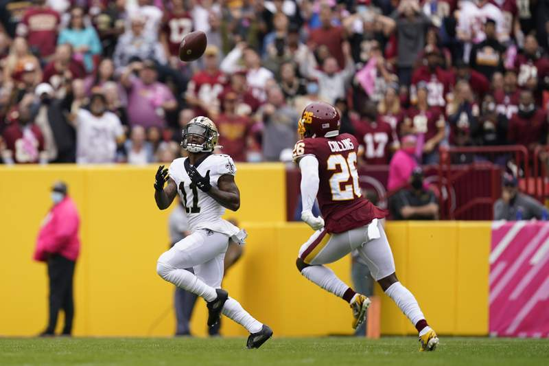 New Orleans Saints wide receiver Deonte Harris, left, catches a pass for a touchdown in front of Washington Football Team safety Landon Collins the first half of an NFL football game, Sunday, Oct. 10, 2021, in Landover, Md. (AP Photo/Alex Brandon)