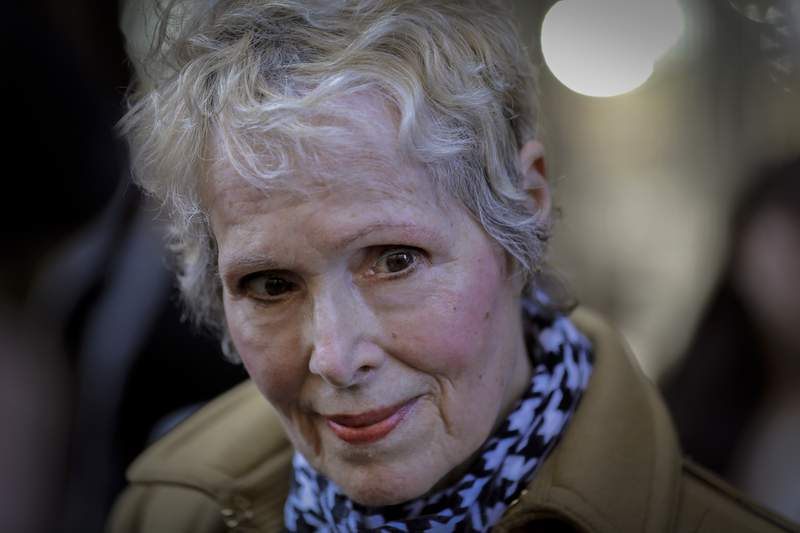FILE - In this photo from Wednesday, March 4, 2020, E. Jean Carroll talks to reporters outside a courthouse in New York. A New York judge has knocked down President Donald Trumps bid to delay a lawsuit from Carroll, who accused him of rape. Manhattan judge Verna Saunders says in a decision released Thursday, Aug. 6, 2020 that the presidency doesnt shield Trump in the case.  (AP Photo/Seth Wenig, File)