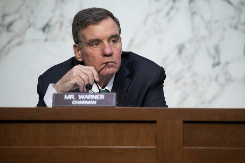 """FILE - In this April 14, 2021, file photo Sen. Mark Warner, D-Va., listens during a Senate Select Committee on Intelligence hearing about worldwide threats, on Capitol Hill in Washington. Democratic-led congressional committees are vowing to press President Joe Bidens administration on what went wrong as the Taliban swept to power in Afghanistan, leaving scores of Americans and the thousands who helped them over the years in grave danger and supplying insurgents with a massive cache of U.S. weaponry. Warner, chairman of the Senate Intelligence Committee, said he would work with other committees to ask tough questions about why we werent better prepared for a worst-case scenario."""" (Saul Loeb/Pool via AP, File)"""