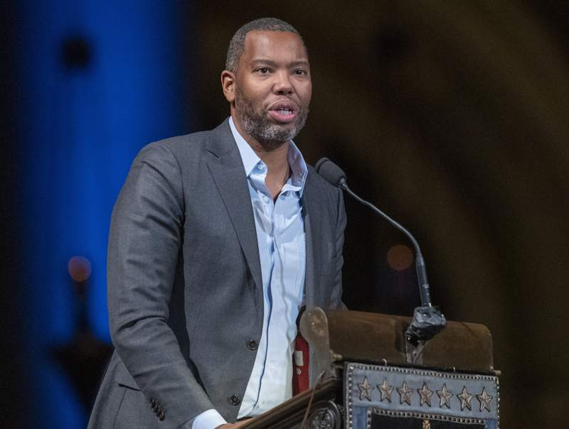FILE - Author Ta-Nehisi Coates speaks during the Celebration of the Life of Toni Morrison in New York on Nov. 21, 2019. Coates, the acclaimed essayist and novelist who expanded the world of Wakanda in Marvel comics, will write the script for a new Superman film from Warner Bros. The studio announced Friday that Coates will pen the screenplay for an upcoming Superman film thats early in development. (AP Photo/Mary Altaffer, File)