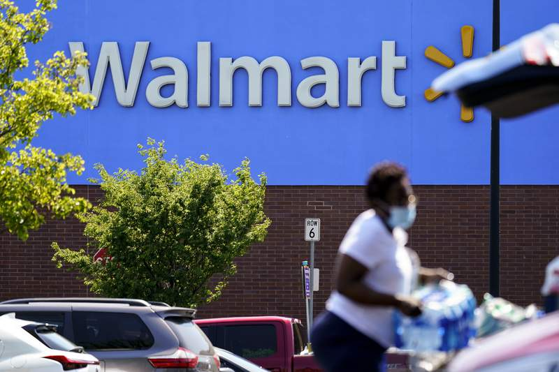A shopper loads items into her car in the parking lot of a Walmart in Willow Grove, Pa., Wednesday, May 19, 2021. Walmart says it will start commercializing its delivery service, using contract workers, autonomous vehicles and even drones to deliver other retailers' products directly to their customers' homes as fast as just a few hours. (AP Photo/Matt Rourke)