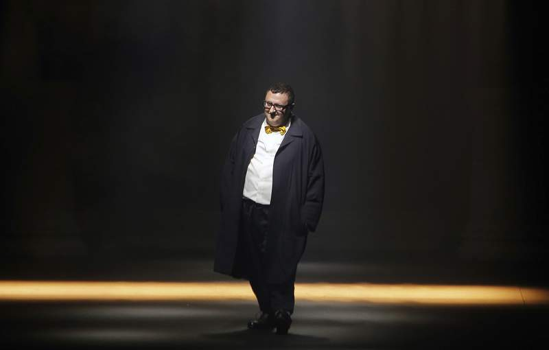 FILE - In this file photo dated Thursday, Oct. 1, 2015, Israeli fashion designer Alber Elbaz acknowledges applause at the end of his Spring-Summer 2016 ready-to-wear fashion collection for Lanvin, presented during the Paris Fashion Week, in Paris. Elbaz, best known for being at the helm of Lanvin from 2001 to 2015, has died at the age of 59, luxury conglomerate Richemont said. Fashion French daily Womens Wear Daily said Elbaz died on Saturday, April 24, 2021 at a Paris hospital. In a statement released on Sunday, Richemonts chairman Johann Rupert said it was with shock and enormous sadness that I heard of Albers sudden passing. Alber had a richly deserved reputation as one of the industrys brightest and most beloved figures. (AP Photo/Thibault Camus, File)