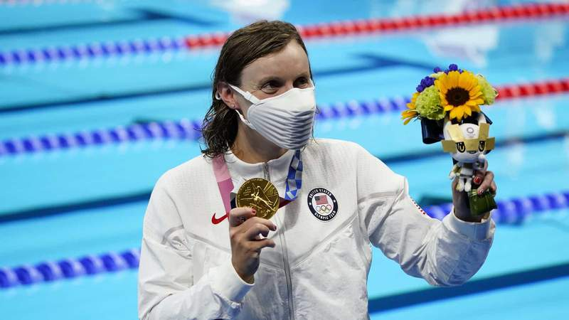 Katie Ledecky shows off her first gold medal of the Tokyo Olympics on Wednesday