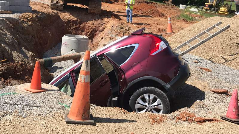 A car drove into a hole at a Roanoke County construction site on Wednesday morning.