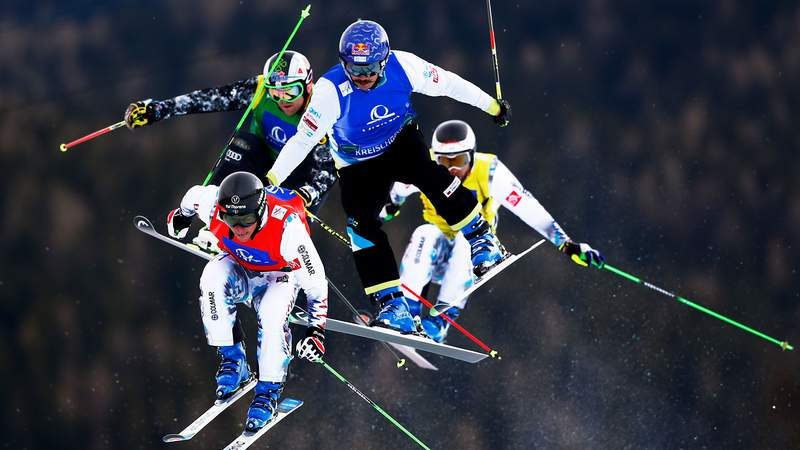 Freestyle skiers compete in the semi final of the Men's Ski Cross Finals during the FIS Freestyle Ski and Snowboard World Championships 2015 on Jan. 25, 2015, in Kreischberg, Austria.
