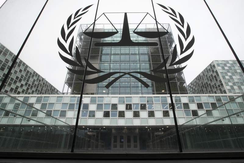 FILE- In this Nov. 7, 2019 file photo, the International Criminal Court, or ICC, is seen in The Hague, Netherlands. President Donald Trump has lobbed a broadside attack against the International Criminal Court. He's authorizing economic sanctions and travel restrictions against court workers directly involved in investigating American troops and intelligence officials for possible war crimes in Afghanistan without U.S. consent. The executive order Trump signed on Thursday marks his administrations latest attack against international organizations, treaties and agreements that do not hew to its policies. (AP Photo/Peter Dejong, File)