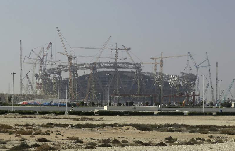 FILE - In this Dec. 20, 2019 file photo, construction is underway at the Lusail Stadium, one of the 2022 World Cup stadiums, in Lusail, Qatar. A U.N. labor body says new labor rules in the energy-rich nation of Qatar effectively dismantles the countrys long-criticized kafala employment system. The International Labor Organization said Sunday, Aug. 30, 2020, that as of now, migrant workers can change jobs before the end of their contracts without obtaining the permission of their current employers. (AP Photo/Hassan Ammar, File)