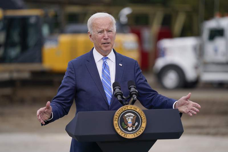 """President Joe Biden delivers remarks on his """"Build Back Better"""" agenda during a visit to the International Union Of Operating Engineers Local 324, Tuesday, Oct. 5, 2021, in Howell, Mich. (AP Photo/Evan Vucci)"""