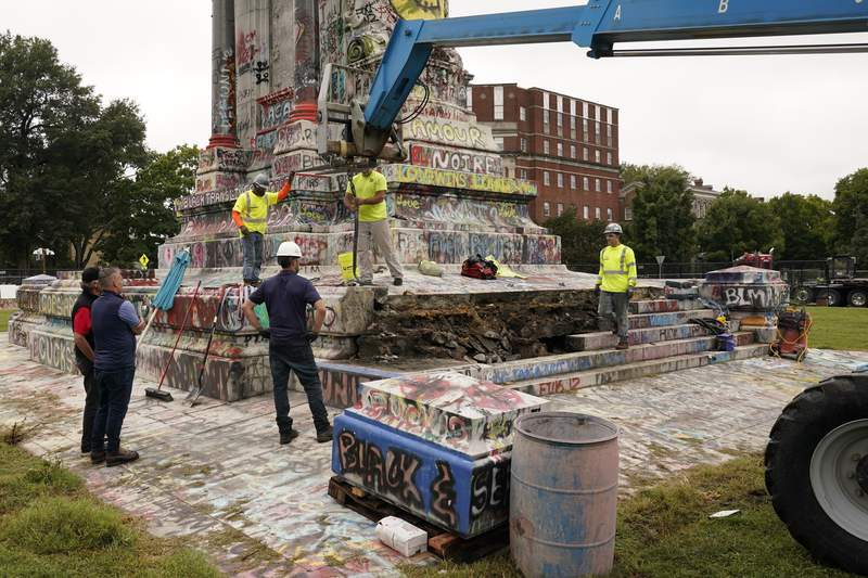Crews dismantle the corner of the pedestal of the Robert E. Lee statue as they attempt to locate a time capsule thought to be buried in the base on Monument Avenue in Richmond, Va., Thursday, Sept. 9, 2021. The statue was removed from the pedestal on Sept. 8. (AP Photo/Steve Helber)