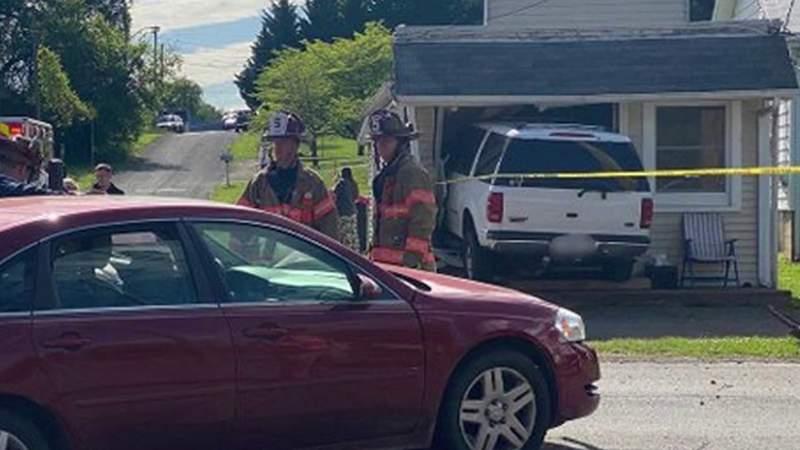 SUV crashes into small building in Roanoke
