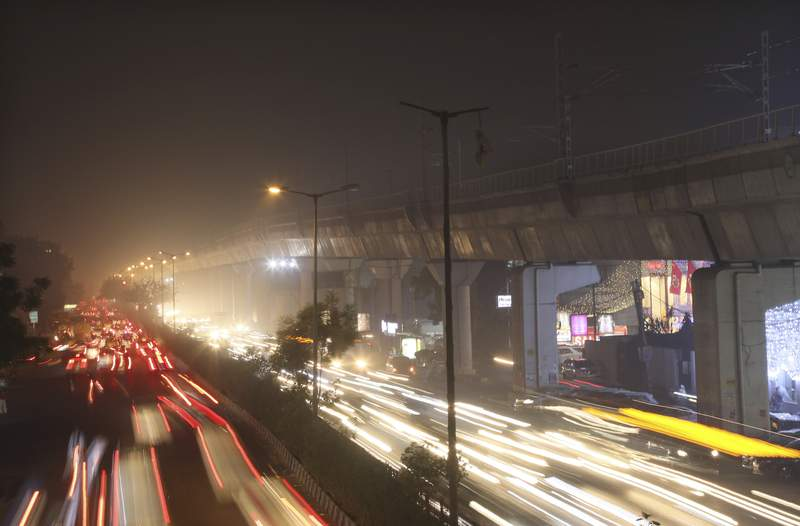 Cars drive on a road engulfed in smog in New Delhi, India, Thursday, Nov. 5, 2020. A thick quilt of smog lingered over the Indian capital and its suburbs on Friday, fed by smoke from raging agricultural fires that health experts worry could worsen the citys fight against the coronavirus. Air pollution in parts of New Delhi have climbed to levels around nine times what the World Health Organization considers safe, turning grey winter skies into a putrid yellow and shrouding national monuments. (AP Photo/Manish Swarup)
