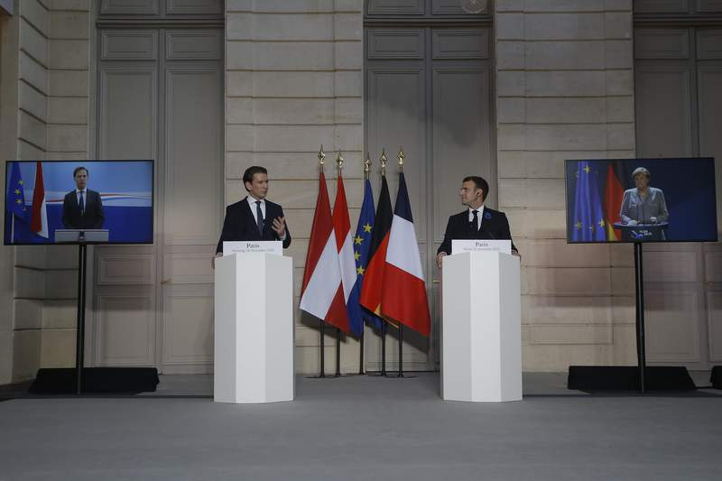 French President Emmanuel Macron, center right, and Austrian Chancellor Sebastian Kurz attend a videoconference with Dutch Prime Minister Mark Rutte, German Chancellor Angela Merkel, European Council President Charles Michel and European Commission President Ursula von der Leyen at the Elysee Palace, in Paris, Tuesday, Nov. 10, 2020. The leaders of France, Germany, Austria and the EU are meeting Tuesday to discuss Europe's response to terrorism threats after a string of attacks. Macron and Kurz are meeting in person after both of their countries have lost lives to Islamic extremist attackers in recent weeks. (AP Photo/Michel Euler, Pool)