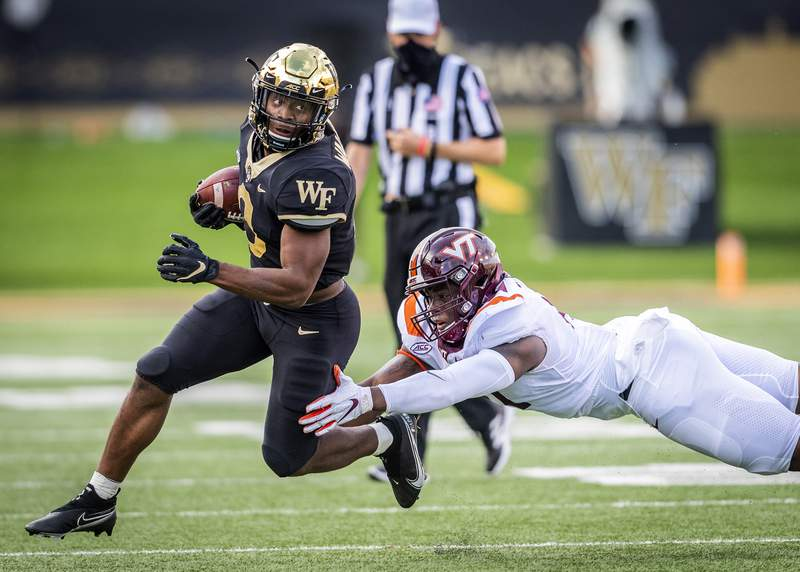 Wake Forest sophomore running back Kenneth Walker III (9) runs the ball through an attempted tackle on Saturday, Oct. 24, 2020 at Truist Field in Winston-Salem, N.C. (Winston-Salem Journal/Andrew Dye) 102520-wsj-spt-wakefootball