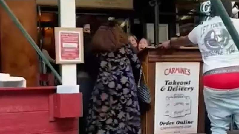 A still from video of the confrontation at Carmines in New York on Thursday, Sept. 16, 2021.
