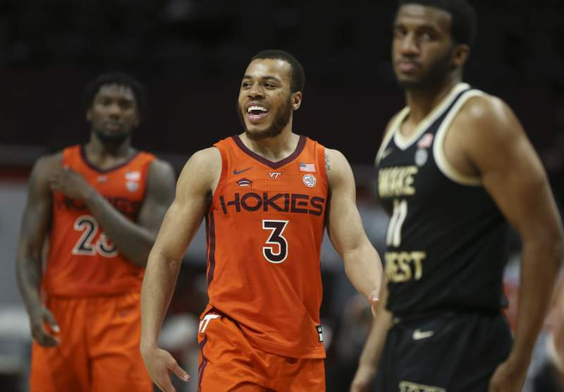 Virginia Tech's Wabissa Bede (3) celebrates a score during the second half of an NCAA college basketball game in Blacksburg Va. Saturday February 27 2021. (AP Photo /  MATT GENRTY, The Roanoke Times, Pool)