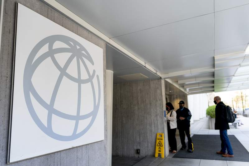 FILE - This April 5, 2021 file photo shows the World Bank building in Washington.  The World Bank is upgrading the outlook for global growth this year, predicting that COVID-19 vaccinations and massive government stimulus in rich countries will power the fastest worldwide expansion in nearly five decades. In its latest Global Economic Prospects report, out Tuesday, June 8,  the 189-country anti-poverty agency forecasts that the world economy will grow 5.6% this year, up from the 4.1% it forecast in January.  (AP Photo/Andrew Harnik, File)