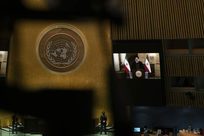Iran's President President Ebrahim Raisi remotely addresses the 76th session of the United Nations General Assembly in a pre-recorded message, Tuesday, Sept. 21, 2021 at UN headquarters. (Eduardo Munoz/Pool Photo via AP)