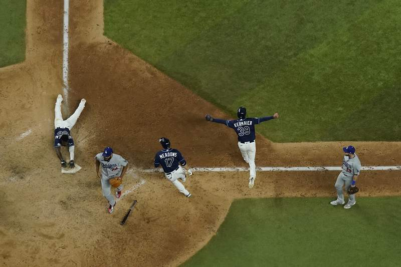 during the == inning in Game 4 of the baseball World Series Saturday, Oct. 24, 2020, in Arlington, Texas. Rays defeated the Dodgers 8-7 to tie the series 2-2 games. (AP Photo/David J. Phillip)