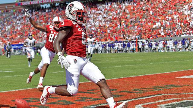 Tabari Hines #5 of the North Carolina State Wolfpack scores a touchdown against the East Carolina Pirates during the second half of their game at Carter-Finley Stadium on August 31, 2019 in Raleigh, North Carolina. (Photo by Grant Halverson/Getty Images)