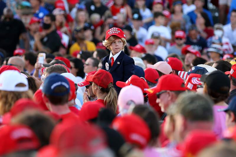 A young supporter looks on before a rally for President Donald Trump on Oct. 23, 2020 in Pensacola, Florida.