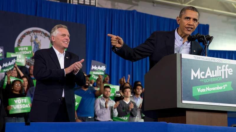 President Barack Obama, right, speaks at a campaign event for Virginia Democratic gubernatorial candidate Terry McAuliffe, left, at Washington-Lee High School in Arlington, Va. on Sunday, Nov. 3, 2013. (AP Photo/Jacquelyn Martin)