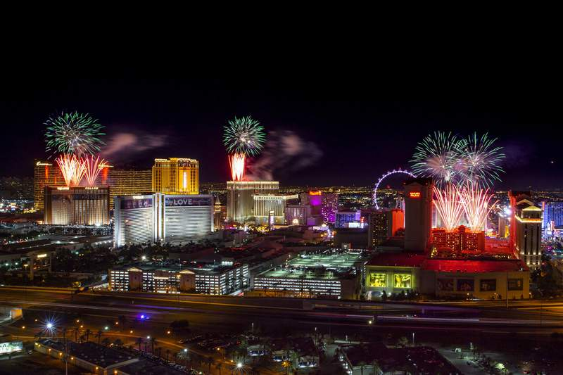 FILE - In this Jan. 1, 2020, file photo, fireworks for New Year's Eve erupt over the Strip in Las Vegas. Regulators say Nevadas largest casinos reaped more than $2 billion from gambling, room rentals, food and beverage sales, and other customer offerings during the 2019 fiscal year. The Nevada Gaming Control Board annual gaming abstract issued Friday, Feb. 7, 2020, looked at financial information from 290 casinos grossing $1 million or more from gambling during the 12-month span ending last June 30. (L.E. Baskow/Las Vegas Review-Journal via AP, File)