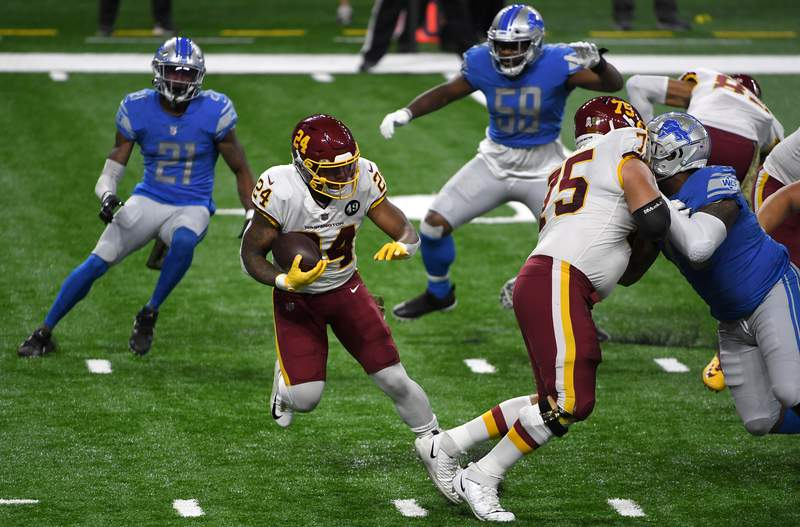DETROIT, MICHIGAN - NOVEMBER 15: Antonio Gibson #24 of the Washington Football Team attempts to run the ball during their game against the Detroit Lions at Ford Field on November 15, 2020 in Detroit, Michigan. (Photo by Nic Antaya/Getty Images)