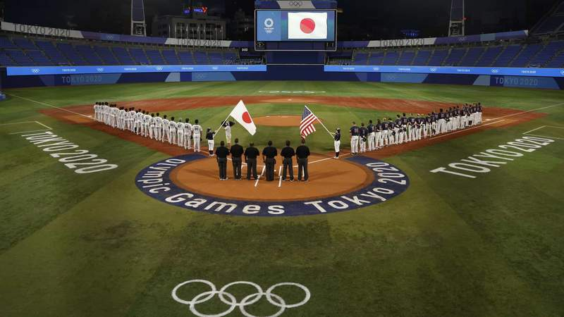 Japan and the USA line up the national anthems before the baseball gold medal game.