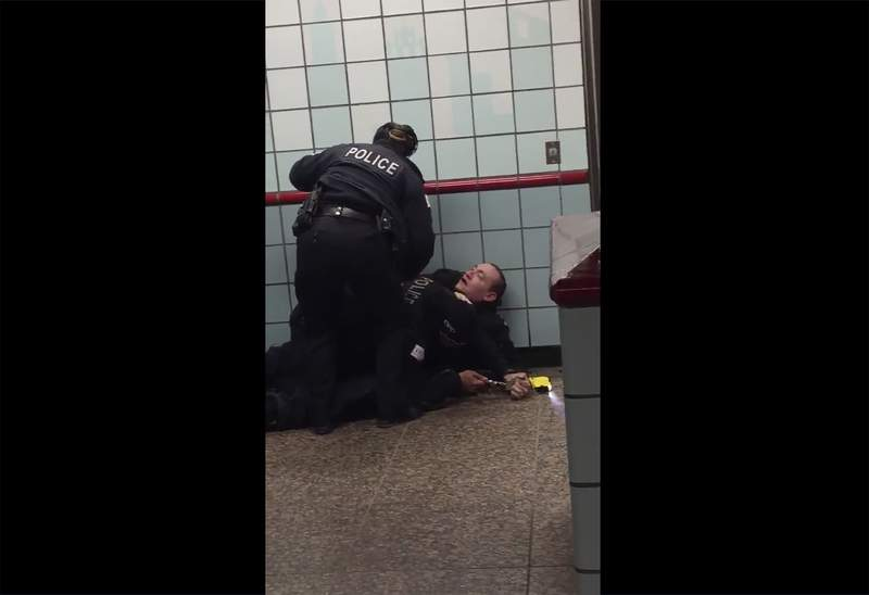 This Friday, Feb. 28, 2020 image from cellphone video shows Chicago police officers trying to apprehend a suspect inside a downtown Chicago train station. After a struggle with police, the suspect was shot as he fled up the escalator with the officers in pursuit.  Mayor Lori Lightfoot said video footage of police shooting and wounding the suspect is extremely disturbing and that she supports the interim police superintendent's request for prosecutors to be sent directly to the scene.  (Michael McDunnah via AP)