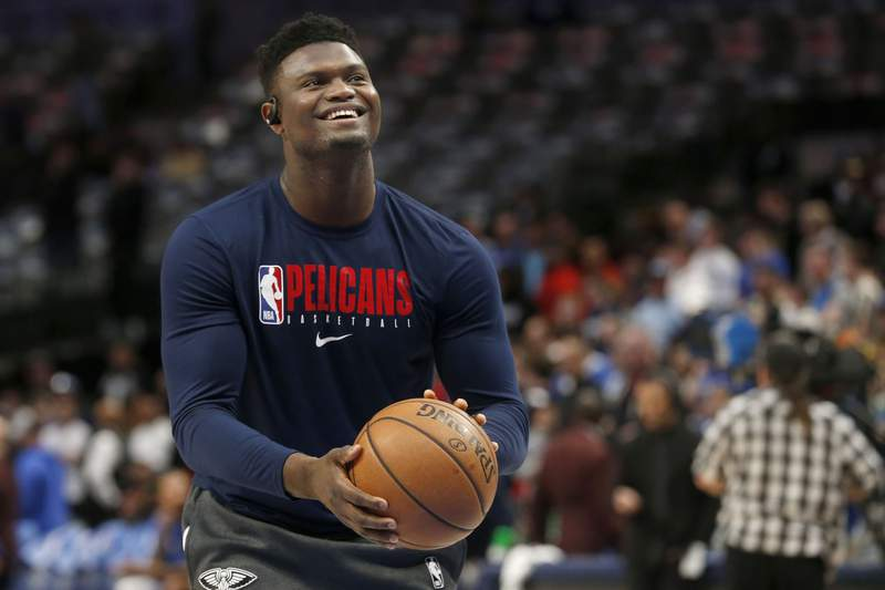 FILE - In this March 4, 2020, file photo, New Orleans Pelicans forward Zion Williamson shoots free throws prior to an NBA basketball game against the Dallas Mavericks in Dallas. The NBA said Saturday, July 25, 2020, that Williamson will have to serve a four-day quarantine for leaving the leagues Disney bubble on July 16 to tend to an urgent family matter. (AP Photo/Michael Ainsworth, File)
