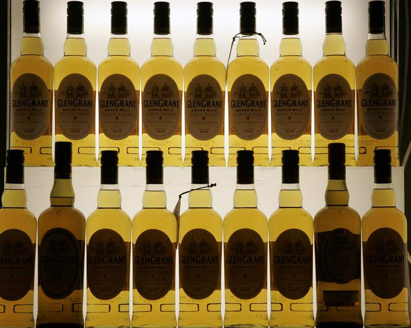 FILE- This Friday, Nov. 13, 2009, file photo, shows Scotch bottles in Cologne, Germany. Scotch whisky makers are breathing a sigh of relief after the United States agreed to suspend tariffs on one of Scotlands main exports. U.S. President Donald Trump imposed a 25% tariff on single malt Scotch whisky in 2019 as part of a trade dispute between the U.S. and EU countries over aerospace subsidies. (AP Photo/Hermann J. Knippertz, File)