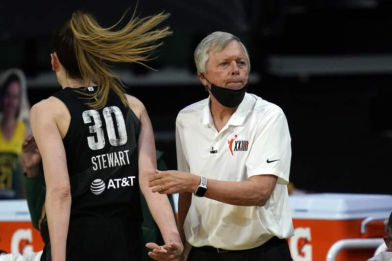 FILE - Seattle Storm head coach Dan Hughes looks toward the court in the first half of a WNBA basketball game against the Las Vegas Aces in Everett, Wash., in this Saturday, May 15, 2021, file photo. Storm coach Dan Hughes abruptly announced his retirement on Sunday, May 30, 2021, saying the rigors of being a head coach in the WNBA has taken a toll. (AP Photo/Elaine Thompson, File)