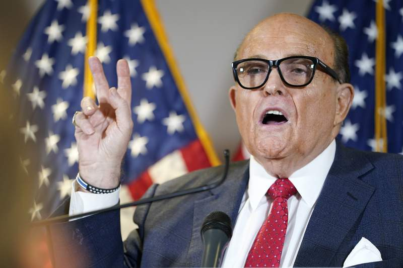 FILE - Former Mayor of New York Rudy Giuliani, a lawyer for President Donald Trump, speaks during a news conference at the Republican National Committee headquarters, Thursday Nov. 19, 2020, in Washington. President Donald Trump says his personal attorney Rudy Giuliani has tested positive for coronavirus.  The president on Sunday, Dec. 6, 2020 confirmed in a tweet that Giuliani had tested positive for the virus. Giuliani has traveled extensively to battleground states in effort to help Trump subvert his election loss. (AP Photo/Jacquelyn Martin, file)