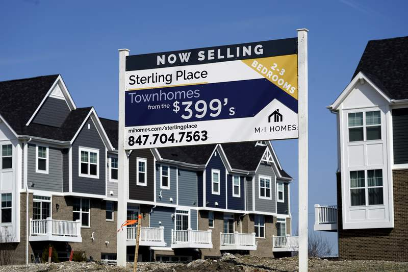 This March 21, 2021 photo shows an advertising sign for building land stands in front of a new home construction site in Northbrook, Ill. Mortgage rates were mostly lower this week, Thursday, June 17,  as the economy continued to show signs of recovery from the pandemic recession and recent bursts of inflation were deemed temporary by federal policymakers.   (AP Photo/Nam Y. Huh)