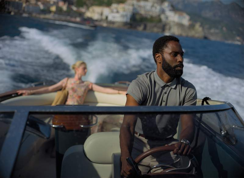 "This image released by Warner Bros. Entertainment shows Elizabeth Debicki, left, and John David Washington in a scene from ""Tenet."" After several months in pandemic-altered theaters, Christopher Nolans Tenet will head to home release on Dec. 15, Warner Bros. said Thursday.  (Melinda Sue Gordon/Warner Bros. Entertainment via AP)"
