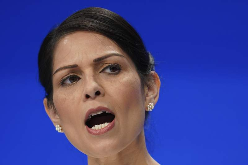 FILE - In this Tuesday, Oct. 5, 2021 file photo, Britain's Home Secretary Priti Patel speaks at the Conservative Party Conference in Manchester, England. The chief executive of Britains biggest phone company, BT, proposed the walk me home service in a letter to Home Secretary Priti Patel, saying it would complement the existing nationwide emergency number. Once a woman activated an app on her phone, the service would track her journey and send an alert to her emergency contacts if she didnt reach her destination on time, Philip Jansen said in the letter. (AP Photo/Jon Super, File)
