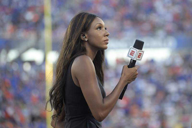 FILE - In this Aug. 24, 2019, file photo, ESPN's Maria Taylor works from the sideline during the first half of an NCAA college football game between Miami and Florida in Orlando, Fla. Taylor is leaving ESPN after the two sides were unable to reach an agreement on a contract extension. Taylor had been with ESPN since 2014 but her contract expired Tuesday, July 20, 2021. Her last assignment for the network was Tuesday night at the NBA Finals, where she was the pregame and postgame host for the network's NBA Countdown show.  (AP Photo/Phelan M. Ebenhack, File)