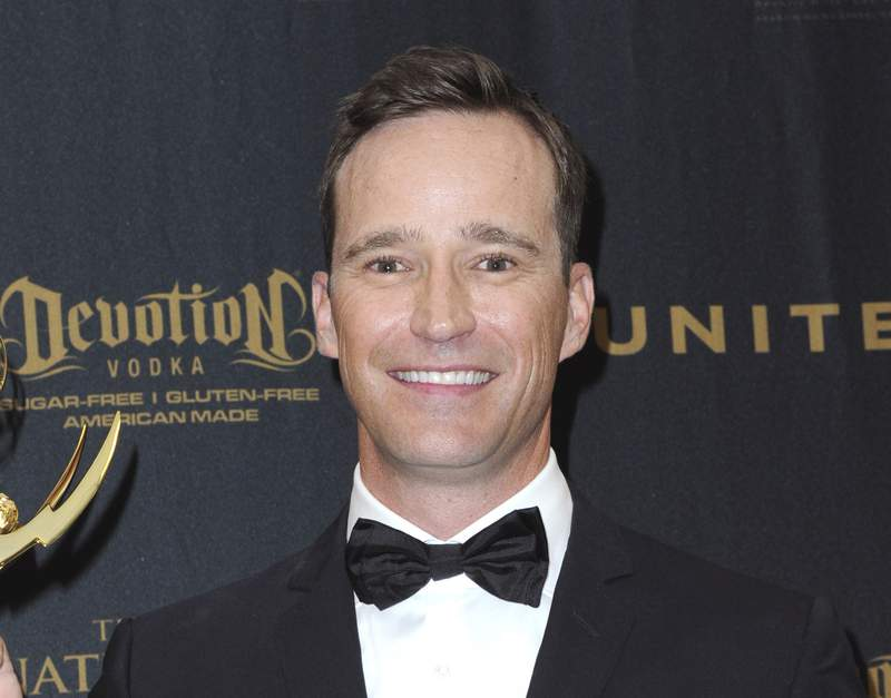 """FILE - Producer Mike Richards poses in the pressroom at the 43rd annual Daytime Emmy Awards on May 1, 2016, in Los Angeles. Richards is out as executive producer of Jeopardy!, days after he exited as the quiz shows newly appointed host because of past misogynistic and other comments. Richards is also no longer executive producer of Wheel of Fortune."""" (Photo by Richard Shotwell/Invision/AP, File)"""