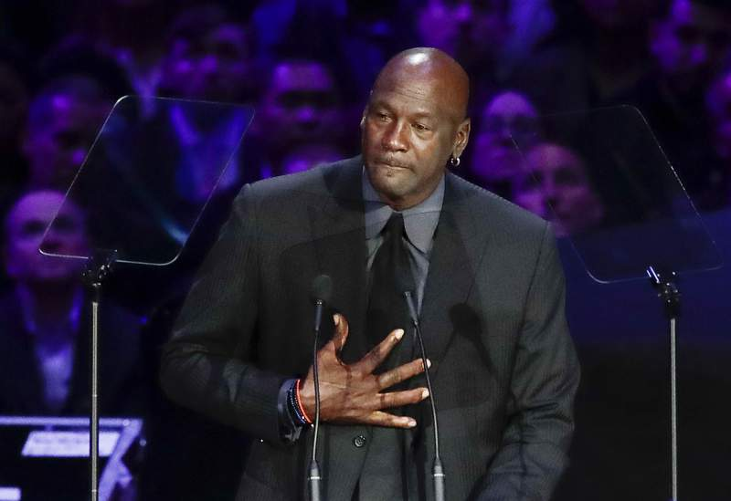 """FILE - In this Feb. 24, 2020, file photo, former NBA player Michael Jordan reacts while speaking during a celebration of life for Kobe Bryant and his daughter Gianna in Los Angeles. Jordan is """"deeply saddened, truly pained and plain angry."""" With protesters taking to the streets across the United States again Sunday, May 31, Jordan released a statement on George Floyd and the killings of black people at the hands of police. (AP Photo/Marcio Jose Sanchez, File)"""